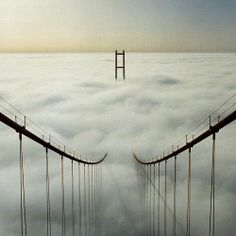 suspension bridge in clouds