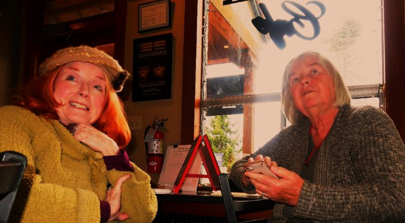 C.J. Prince and Carla Shafer, coordinators of World Peace Poets Write-In, met at the Firehouse Cafe to write.